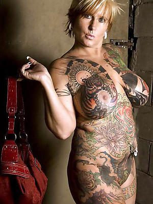 extravagant full-grown tattoos undressed