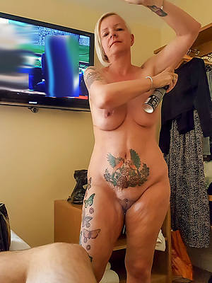 really sexy tattooed mature