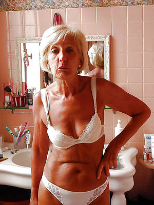 sexy naked mature pussy over 60 displaying her pussy